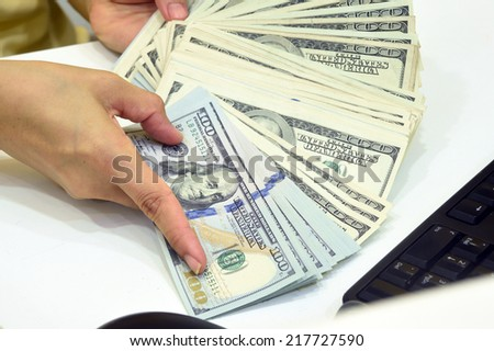 100 US dollar money in hand - stock photo