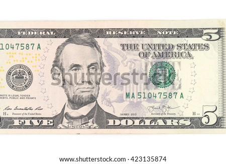5  US dollar money isolated on white.