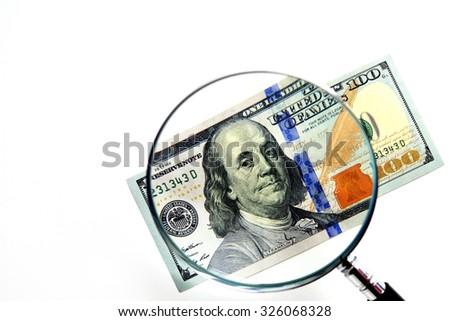 100 US Dollar under magnifying glass - stock photo