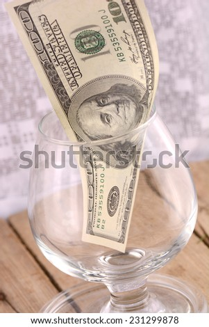 100 US dollars bank notes in a glass jar - stock photo