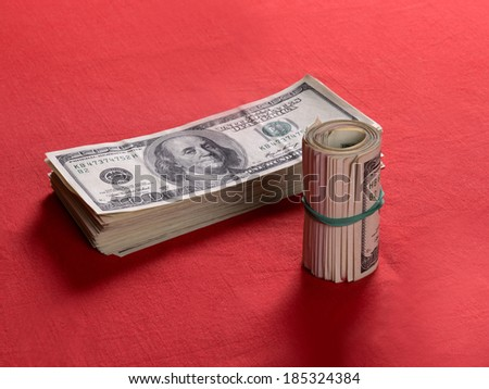 US dollars bills  on red background