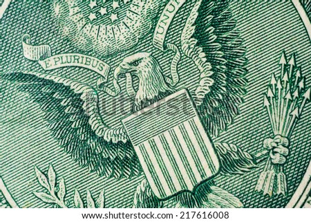 US one (1 ) dollar bill in a macro shot, super macro, close up photo. Shallow depth of field effect. Great Seal of the United States Logo. - stock photo