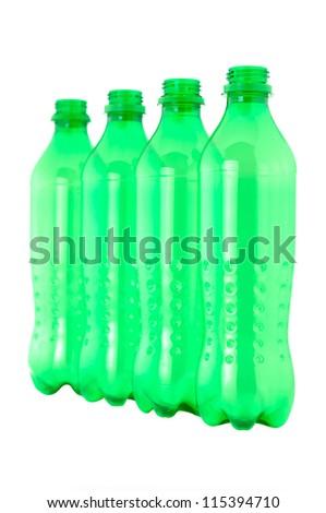 used plastic green bottles on white background - stock photo