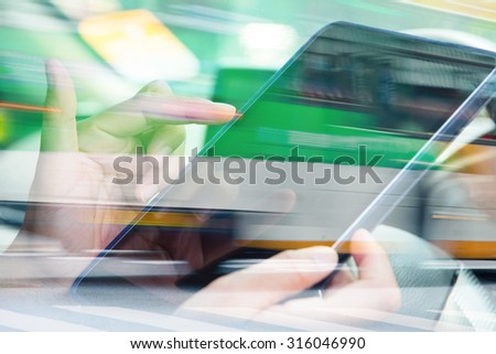 Using digital tablet double exposure and blurred view of car on city street