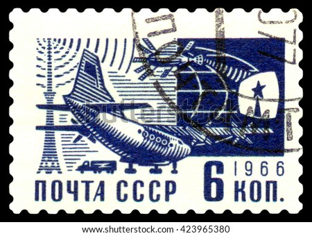 USSR- CIRCA 1966: a stamp printed by USSR, shows  plane and Ostankino television tower, circa1966 - stock photo