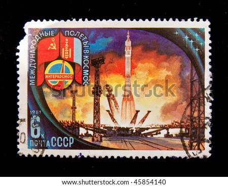 USSR - CIRCA 1981: A stamp printed in the USSR devoted to the Soviet-Polish cooperation in the Intercosmos program shows a spaceship being taken to the launch pad, circa 1981. Big space series