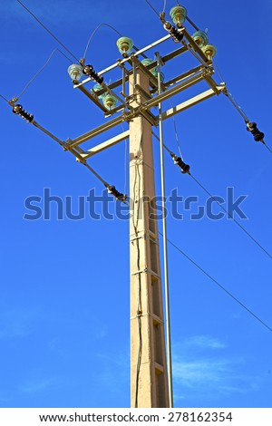 utility pole in africa morocco energy and distribution pylon - stock photo