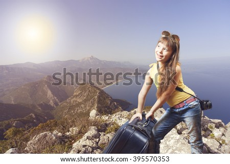vacation, holiday, standing on top of the mountain and enjoying valley view at sunrise