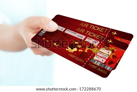 valentine fly tickets holded by hand isolated over white background. Focus on tickets - stock photo