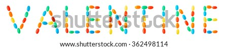 """valentine"" lettering made of multicolored candies isolated on white background"