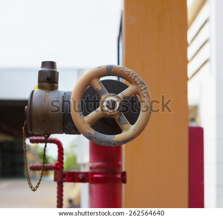 valve Fire hydrant on the sidewalk - stock photo