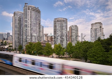 Vancouver Growing Skyline. Modern towers and heritage buildings line Vancouverâ??s skyline behind a rapid transit line. British Columbia, Canada.                             - stock photo