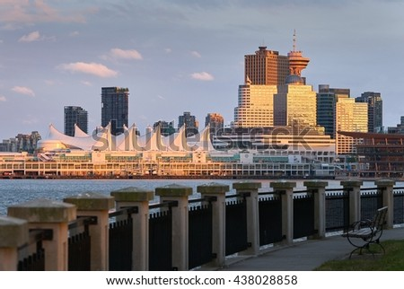 Vancouver Sunset Reflection. Looking across Vancouver's Coal Harbor at sunset. The sun reflects off the downtown office buildings. British Columbia, Canada.                           - stock photo