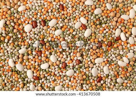 Variety of coloured beans and lentils. Food background - stock photo