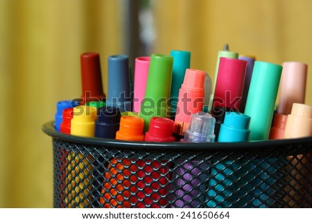 Various color markers in holder.