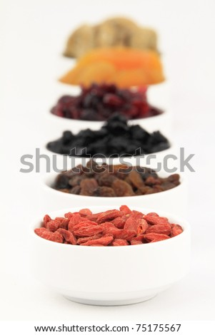 Various dried fruits in bowl - stock photo