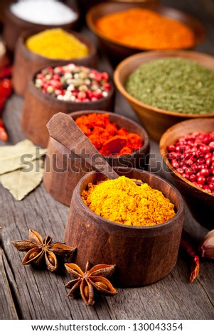 Various kind of spices in wooden bowls - stock photo