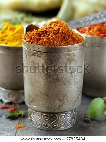 various spices (curcuma, paprika, saffron) in metal bowls - stock photo