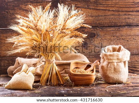 various types of grains and cereals on wooden background - stock photo