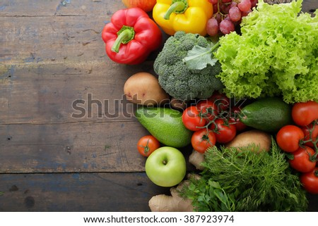 vegetables and fruits on boards with space for text, ingredients