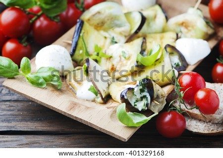 Vegetarian Eggplant rolls with cottage cheese, selective focus - stock photo
