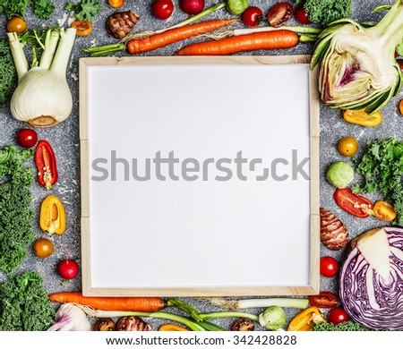 Vegetarian food, health and diet nutrition background with variety of fresh farm vegetables  around a blank white chalkboard, top view, frame. Vegetarian food, health and diet nutrition concept.  - stock photo