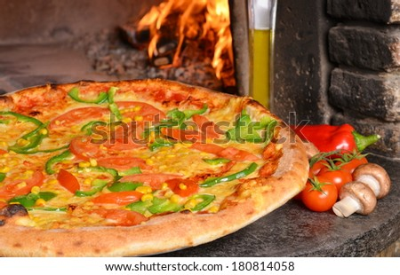 Vegetarian pizza in front of the oven