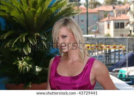 VENICE, ITALY - AUGUST 29: Actress Charlize Theron arrives by boat at the 'The Burning Plain' photocall at the Piazzale del Casino during the 65th Venice Film Festival on August 29, 2008 - stock photo
