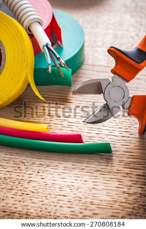 vertical view nippers electric cable rolls of isulating tape heat shrinkable tube - stock photo