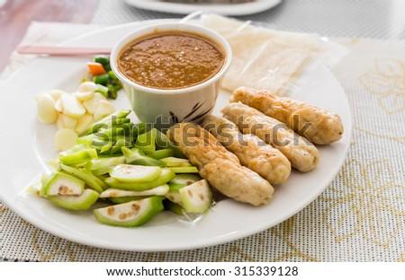 Vietnamese food, Meatball Wraps,Vietnamese Pork Sausage,Nem Neung, spicy pork salad - stock photo