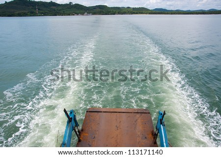 view behind a car ferry. - stock photo