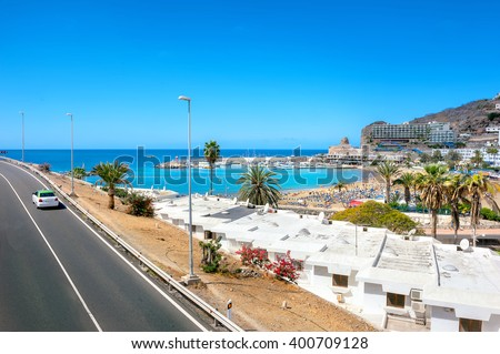 View of highway and Puerto Rico resort town. Gran Canaria. Spain - stock photo