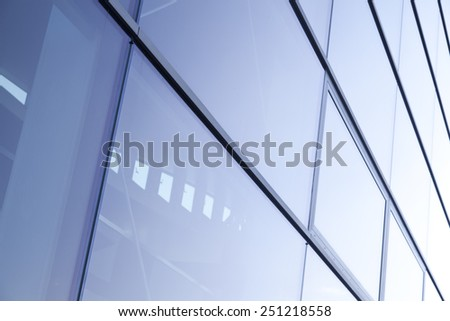 view of steel blue glass high rise building skyscrapers, business concept of successful industrial architecture - stock photo