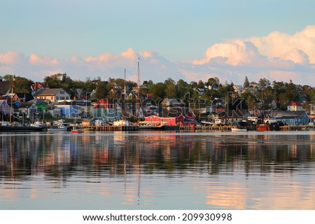 View of the famous harbor front of Lunenburg, Nova Scotia, one of the Maritime Provinces , Canada a UNESCO world heritage site.  - stock photo