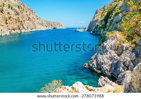 View on sea bay on Greek Island with yacht anchored, Greece