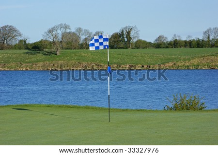 View on the golf flag and lake
