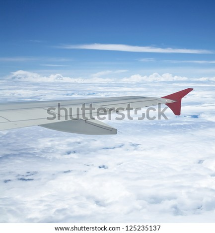 View out of airplane Airplane wing in flight