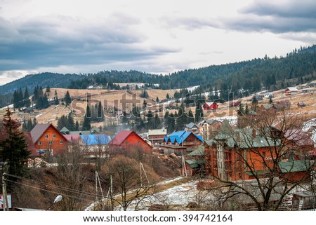 Village in the mountains, snow, mountain, snow, peak, nature, sky, mount,  ridge, beautiful, forest, beauty,  white, view, clouds, panoramic,  trekking,  wooden houses, photo, morning, winter - stock photo