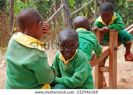 """""""4-08-2014""""-""""Village of Pomerini""""-Tanzania-Africa - The game of kindergarten children built in the Franciscan Mission of the Village of Pomerini-Many of these children are suffering from AIDS.  - stock photo"""