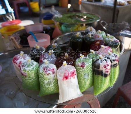 Vine jelly, black grass jelly, basil seeds and poonparai or sterculia lychnophora sold at Tam Nong market, Dong Thap province, Vietnam