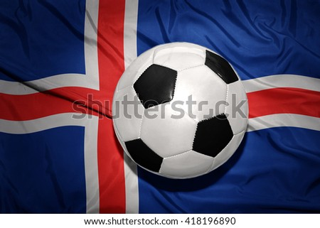 vintage black and white football ball on the national flag of iceland - stock photo