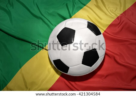 vintage black and white football ball on the national flag of republic congo