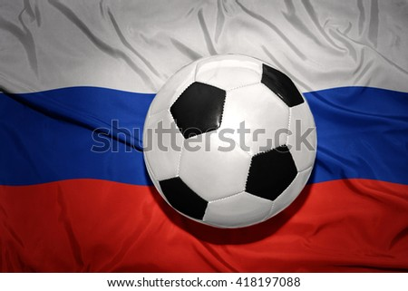 vintage black and white football ball on the national flag of russia - stock photo
