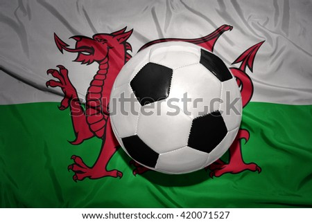vintage black and white football ball on the national flag of wales
