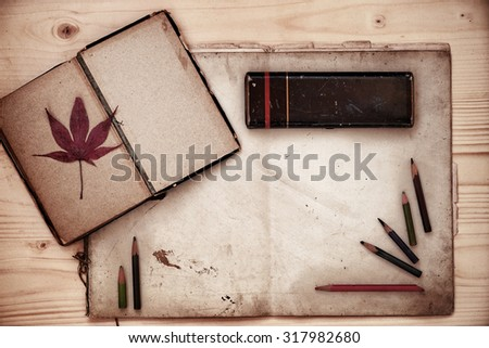 Vintage composition of old book and old paper and other retro objects               - stock photo