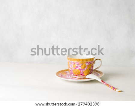 vintage cup, saucer and spoon on a white background - stock photo