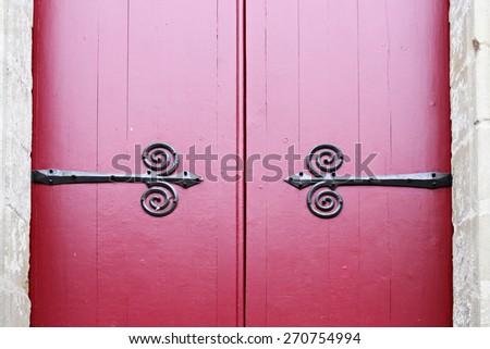 2 vintage doors with red painting and metal pattern