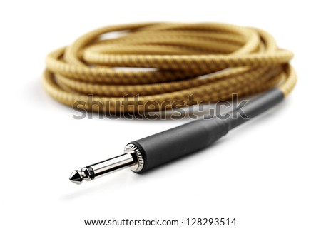 vintage guitar cable isolated - stock photo