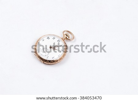 vintage pocket watch isolated - stock photo