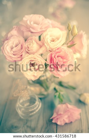 Vintage Still life - Bouquet of beautiful pink flowers on old wooden texture, vertical